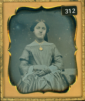 Daguerreotype of a Pretty Lady wearing a gilded locket.